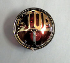 "VINCENT-VELO TAIL / STOP LIGHT ROUND WITH WORD ""STOP"" ON METAL. P/N 93-00102"
