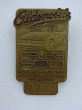 1985 Indianapolis 500 Bronze Pit Badge Olds Calais Danny Sullivan Spin and Win