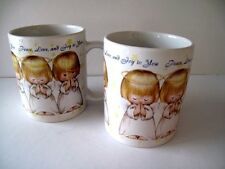 Two Houston Harvest Gift Products Hallmark Mugs with Angels Peace Love and Joy