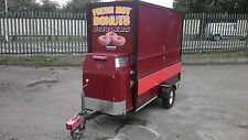 8FT TOWABILITY DOUGHNUT TRAILER WITH DROP DOWN SIDES.