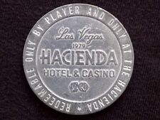 "$1 SLOT / GAMING TOKEN -- 1979 HACIENDA CASINO -- LAS VEGAS, NV -- ""OBSOLETE"""