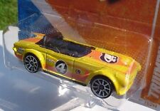 2011 Hotwheels TRIUMPH TR6 Yellow Car #4 TRACK STARS 70/244 NEW in SEALED Pack!