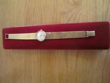 SOLID  GOLD   9K  OMEGA WATCH WITH 9 K SOLID GOLD STRAP 30.3 GRAMS