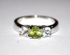 MARKED STER. WOMAN RING SIZE 10 GREEN AND TWO CLEAR STONES STERLING SILVER BAND