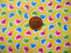 YELLOW WITH PINK, BLUE & GREEN HEARTS FQ OF POLYCOTTON FABRIC