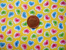 YELLOW WITH PINK, BLUE & GREEN HEARTS OF POLYCOTTON FABRIC BY THE METRE