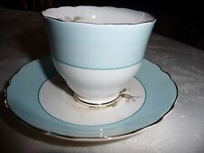 STAFFORDSHIRE CROWN FOOTED TEA CUP AND SAUCER - GRAY BLOSSOM (?)
