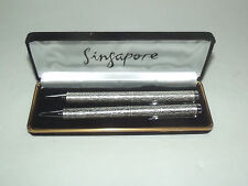 PAIR OF FANCY PENS FROM SINGAPORE AIRLINES WITH LION HEADS WITH A FISH TAIL