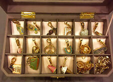 JUICY COUTURE 16 CHARM LOT, 2 BRACELETS AND AN 18 SLOT CHARM STORAGE BOX