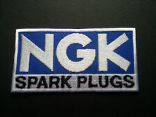 MOTOR RACING RALLY NASCAR SEW / IRON ON PATCH:- N.G.K. SPARK PLUGS (b) BLUE