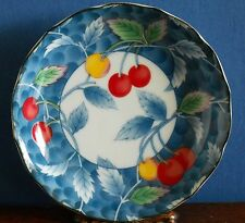 A 13 cm Japanese porcelain dish blue white with coloured cherries