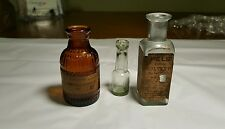 Three Small Medical Bottles