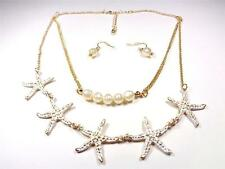 BEACH FASHION GOLD TONE RHODIUM PEARLS AND WHITE STARFISH NECKLACE & EARRINGS