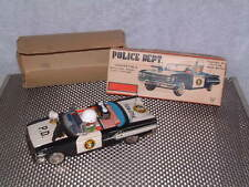 VINTAGE ICHIKO TIN FRICTION DRIVEN POLICE CAR W/ROTATING GUN & SIREN. WITH BOX!