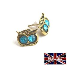 Vintage Style Owl Earrings. Antique Gold effect with blue rhinestone eyes.
