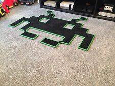 black/green Space Invaders shaped floor mat, rug. Retro gaming room