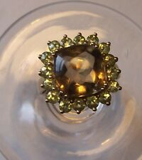 9CT PERIDOT AND SMOKEY QUARTZ RING
