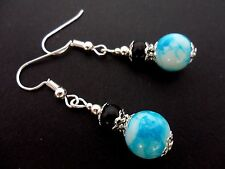 A PAIR BLACK AND BLUE MARBLED GLASS PEARL DANGLY EARRINGS.