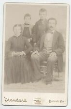 CABINET CARD PARENTS WITH DAUGHTER AND SON. STANDARD PORTRAIT COMPANY.