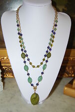 DOUBLE STRAND NECKLACE OF GREEN TONE ACRYLIC BEADS WITH GOLD TONED METAL CHAINS
