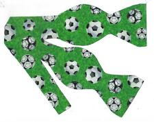 (1) Soccer Ball Self-tie Bow tie - Soccer balls tossed on green
