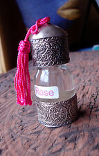 Moroccan rose essential oil 30 ml in an ornate bottle with tassle