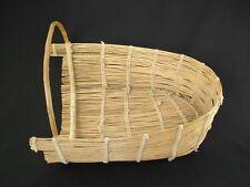 A Pomo Cradle, Native American Indian basket, circa: 1915
