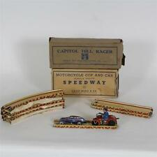 Group of tin windup toys with track Lot 167