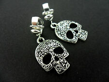 A PAIR TIBETAN SILVER  DANGLY ENGRAVED SKULL CLIP ON EARRINGS.