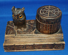 A characterful victorian carved wooden inkwell with owl figure and pen rest