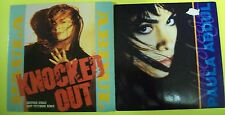 "2 x  7"" VINYL SINGLES by Paula Abdul. Knocked Out and Vibeology."