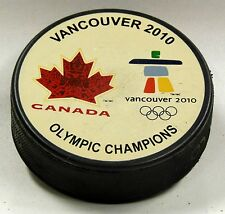 TEAM CANADA GOLD MEDAL VANCOUVER 2010 OLYMPIC CHAMPIONS PUCK OFFWHITE US00506