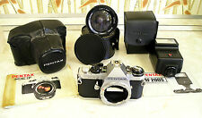 Pentax ME F camera body plus other Pentax parts.
