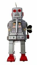 Collectors Silver tin clockwork walking robot with sparking eyes and mouth