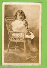 #E.   POSTCARD -  BABY GIRL IN CANE CHAIR
