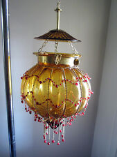 Vintage amber color glass swag lamp shade - dressed with a hand made retro bead