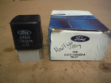 FORD HEADLIGHT DIMMER RELAY  NEW OEM REPLACEMENT E4FZ-13A025-A BOX # 1060