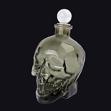 TEMERITY JONES DARK GLASS SKULL DECANTER WITH GLASS STOPPER. GOTHIC HOMEWARE.