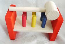 pound a peg wooden toy. early learning Montessori discovery