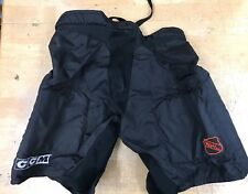 NHL PRO STOCK GAME USED ice hockey PANTS CCM Sz LARGE ORANGE NHL SYMBOL