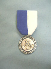 male roadbike racing silver medal blue and white pin ribbon
