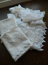 Bundle of 22 items of vintage white table linen with lace and embroidery.