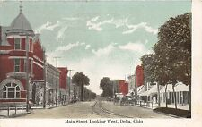 A57/ Delta Ohio Postcard Main Street Looking West Stores Wagons c1910
