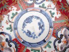 Assiette en porcelaine polychrome Imari à décor floraux d'époque 19ème