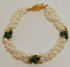 Brand New hand strung 4mm fresh water cultured pearl bracelet with beads.