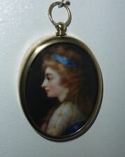 Portrait Miniature of a girl with a blue ribbon in her hair in oval brass frame