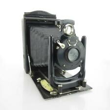 Certo 9x12 con Trio plan 6.3 f = 13,5cm con rollex patente 120 película Back
