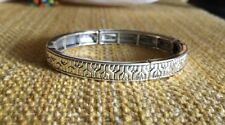 """Silver Bracelet W/ a Tribal/ Wave Design. Stretchy Band. Easy To Put On. 7"""""""