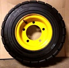 TIRE and RIM NEW, 7.0-12 NHS 14 P.R. TRELLEBORG