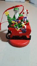 CHRISTMAS ORNAMENT FROM GEICO 2010 GECKO IN A SLEIGH